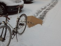 Last night's snowfall provided the perfect opportunity to convert a couple of chunks of scrap wood and the frame of my Carry Freedom Y-Frame trailer into a bike-powered snow plough... excellent!