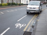 After a winter to bed in, how does the Edinburgh Quality Bike Corridor fare? Is it just a long strip of cycle lane painted underneath de-facto parking bays?