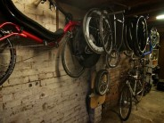 DIY bike workshop update: the bikes, trailers, spare wheels and tyres are now hanging on the wall...